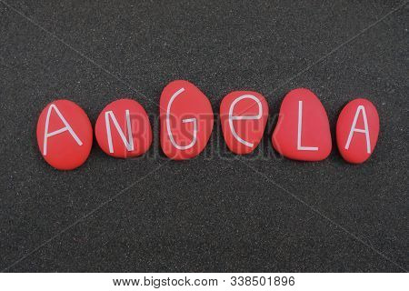 Angela, Female Given Name Composed With Red Colored And Carved Stone Letters Over Black Volcanic San