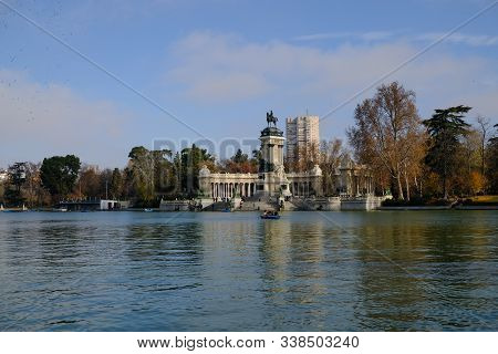 Monument To King Alfonso Xii In The Pond Of The Retiro Park In Madrid