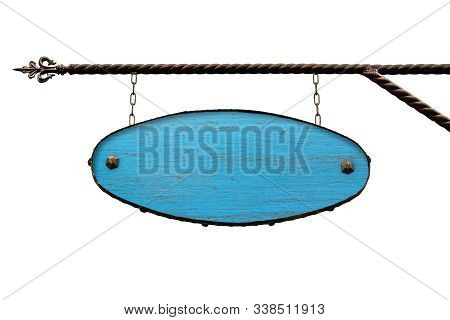 Oval Blue Wooden Signboard. Old Wood Shop Signs Without Text Hanging On The Wrought Iron Structure.