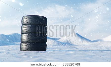 Winter Tires On A Background Of Snowstorm, Snowfall And Slippery Winter Road. Winter Tires Concept.