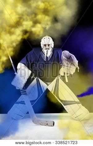 Hockey Goalie Stands And He Is Ready To Catch The Puck.hockey Goalie In Complete Hockey Gear Standin