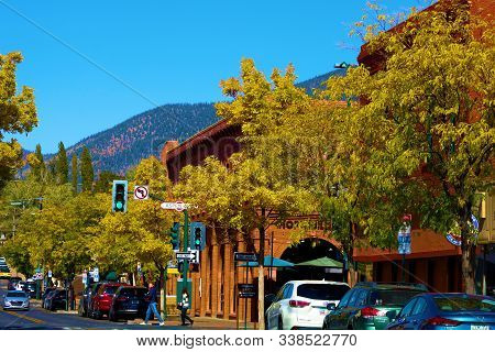October 19, 2019 In Flagstaff, Az:  Deciduous Trees Changing Colors During Autumn Foliage On Street