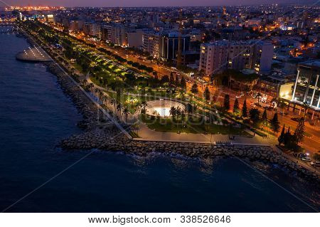 Aerial View Of Limassol Promenade Or Embankment With Alley And Buildings In Cyprus At Night. Drone P