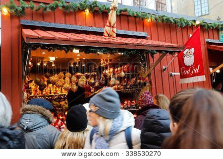 Stockholm, Sweden - Novmber 30, 2019: People Infront Of A Market Stall Visiting The Traditional Chri