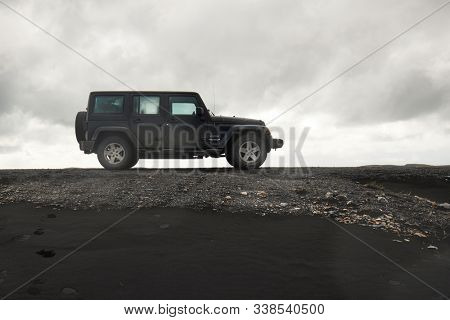 VIK, ICELAND - MAY 03, 2018: Jeep Wrangler Unlimited Sport four wheel drive vehicle being used on terrain driving in Iceland, wild black sand landscape