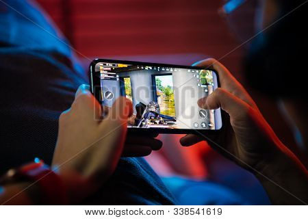 Moscow, Russia - December 6, 2019: Close Up Gamer Hand Holding A Smartphone With Playerunknowns Batt
