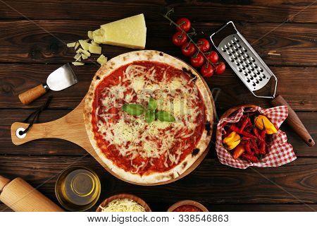 Pizza With Tomatoes, Mozzarella Cheese, Basil. Delicious Italian Pizza On Wooden Pizza Board.