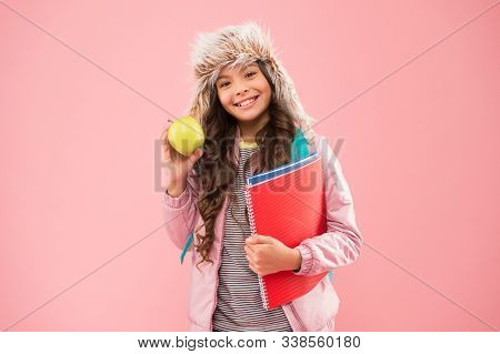 Winter Semester. Teen With Backpack And Books. Healthy Snack. Modern Education. Stylish Schoolgirl.