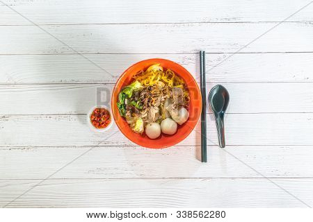 Flat Lay Top View Concept. Asia Singapore Street Food One Bowl Mee Pok Dry Noodle With Minced Pork &