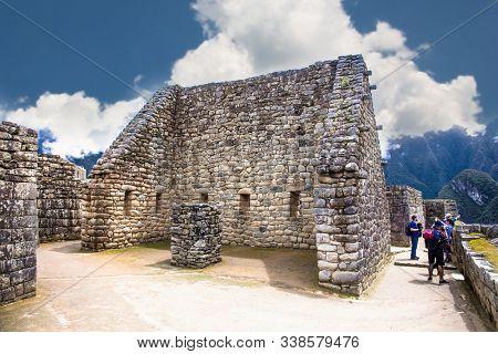 Machu Picchu Pueblo,  Peru - Jan 7, 2019:  Incredible Inca House in Ancient city of Machu Picchu , Peru. South America.  Archaeological site.
