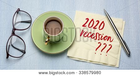 2020 recession? Handwriting on a napkin with a cup of coffee. New Year economy predictions and speculations.