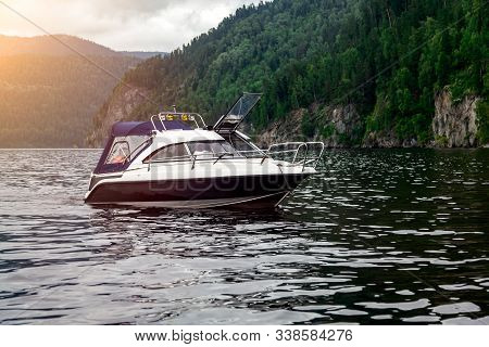 A Small Pleasure Boat With A Motor For Excursions And Relaxation In Picturesque Places On The Water