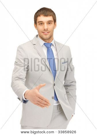 handsome man with an open hand ready for handshake