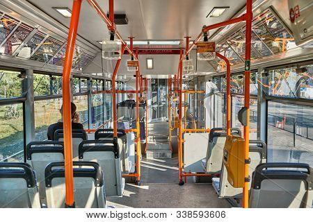 BRNO, CZECH REPUBLIC - April 14, 2018: Public city bus interior on a sunny day, public transportation in Brno
