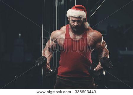 Bodybuilder In Santa Claus Costume In The Gym