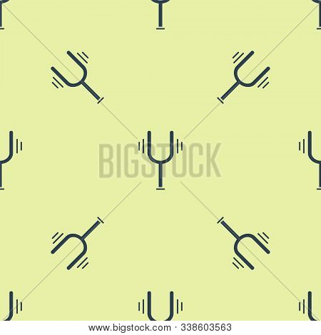 Blue Musical Tuning Fork For Tuning Musical Instruments Icon Isolated Seamless Pattern On Yellow Bac