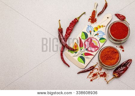 Magyar (hungarian) Red Sweet And Hot Paprika Powder. Traditional Pattern On A Cutting Board, Differe