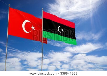 Turkey And Libya Flags Over Blue Sky Background. 3d Illustration