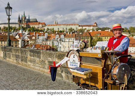 Czech Republic, Prague, October 2005: Street Performer Man With Hat And Bow Tie, Plays Music From A