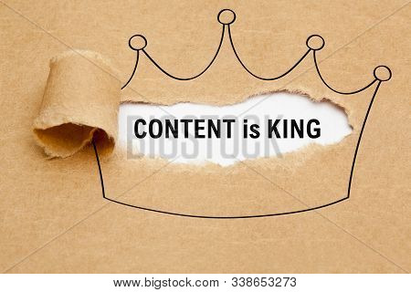 Text Content Is King Appearing Behind Torn Brown Paper In Crown Drawing. Concept About The Importanc
