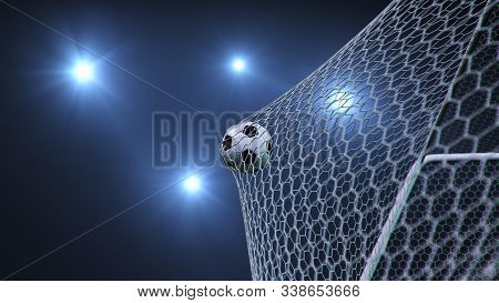 Soccer Ball Flew Into The Goal. Soccer Ball Bends The Net, Against The Background Of Flashes Of Ligh