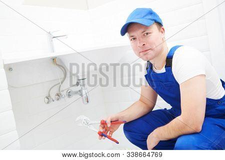 plumber service. Plumber portrait near wash basin siphon installation