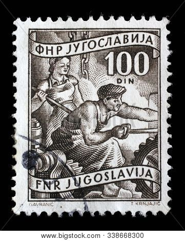 ZAGREB, CROATIA - SEPTEMBER 13, 2014: A stamp issued in Yugoslavia shows Steel worker, Local Economy series, circa 1952.