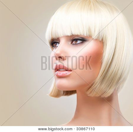 Haircut. Hairstyle. Beautiful Model with short Blond hair