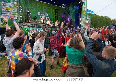 "ETNOMIR, RUSSIA - JUNE 2: Unidentified people having fun on open-air international ethnic music ""Wild Mint"" Festival on June 2, 2012 in Etnomir near Borovsk city, Russia"
