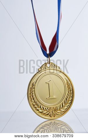 first place golde medal on the white background