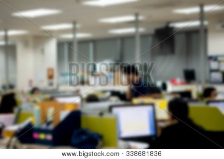 Blur Background In Workplace Or Work Space Of Table In Office Room With Computer. Blurred Office Bac