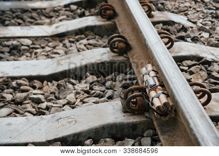 Rusty Metal. Timebomb On The Railway At Daytime Outdoors. Conception Of Terrorism And Danger.