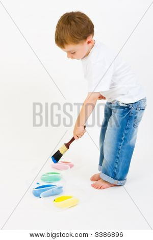 A Small Boy With Paint