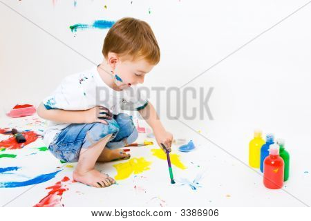 Child Painting The Floor