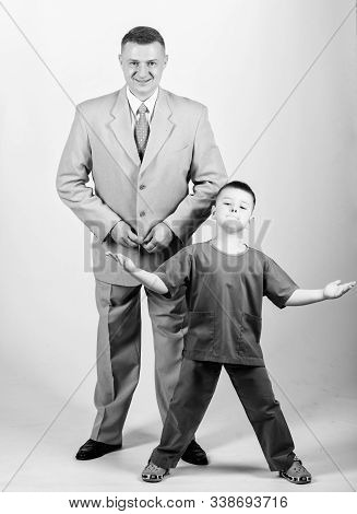 Dad Boss. Father And Cute Small Son. Child Care Development Upbringing. Respectable Profession. Fami