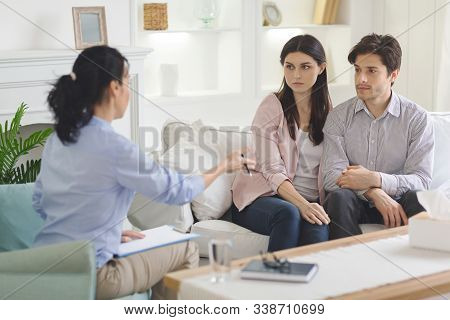 Family Therapist Talking To Young Married Couple, Giving Advices, Compromising Family Routine, Empty