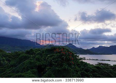 The Colors Of A Sunset Illuminate The Tropical Landscape Of Windward Oahu, Hawaii.
