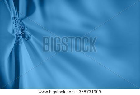 Classic Blue Dress With Embroidered Elements And Beads. Copy Space On Textile Folds.