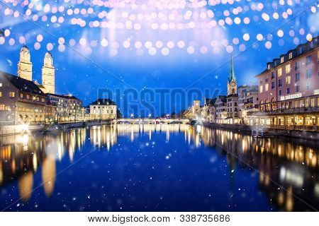 snowfall in Zurich city center with famous Fraumunster and Grossmunster Churches and river Limmat at Lake Zurich, Canton of Zurich, Switzerland