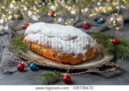 Stollen With Raisins, Candied Fruits, Almonds And Spices On A Metal Tray. Traditional Christmas Holi