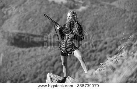 Sexy Warrior. She Is Warrior. Warrior Mountains Landscape Background. Amazon Legendary Race Of Femal