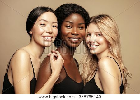Beauty. Multi Ethnic Group Of Womans With Diffrent Types Of Skin  Together And Looking On Camera. Di