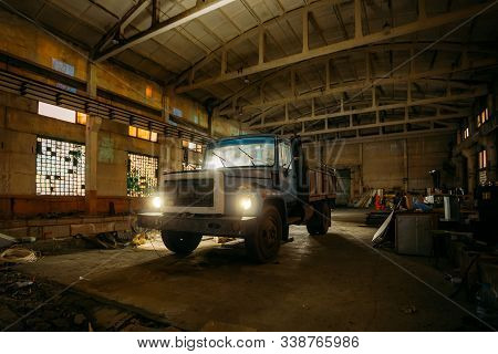Old Rusty Truck In Abandoned Factory Warehouse