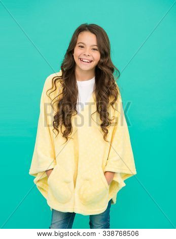 Little Girl With Long Hair. Happy Childhood. Feeling Comfy. Adorable Child On Turquoise Background.