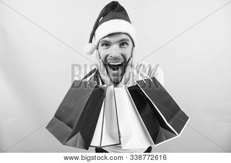 Winter Sale, Shopping Concept. Macho Shopper With Surprised Face Hold Paperbags. Christmas, New Year