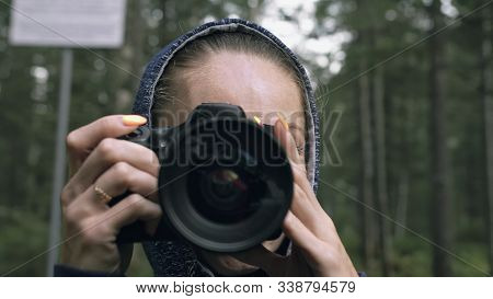 Traveler Photographing Scenic View In Forest. One Caucasian Woman Shooting Close Up Look. Girl Take