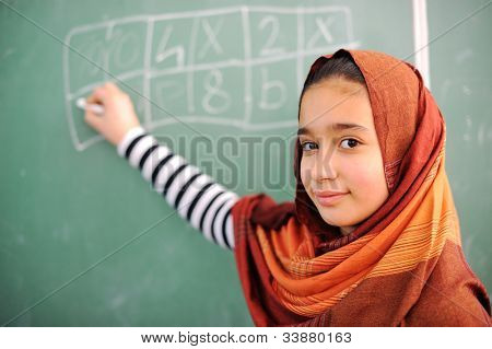 Beautiful arab girl wearing hijab in school
