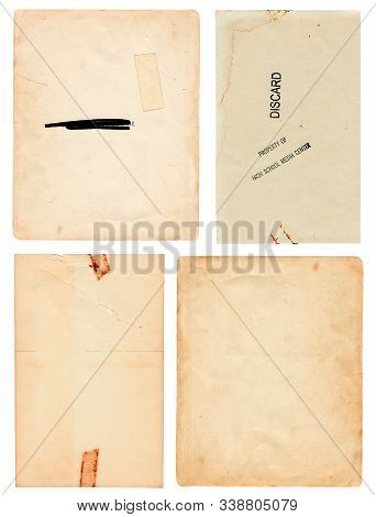 Set Of Four Vintage Papers Salvaged From Old Discarded Library Books Isolated On A White Background.
