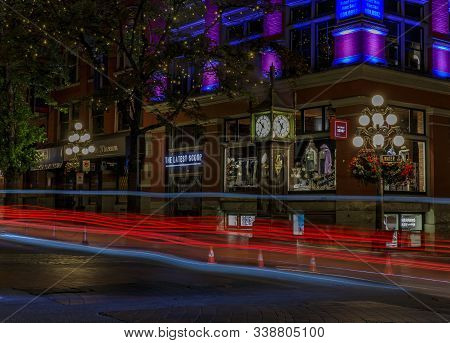 Vancouver, Canada - July 09, 2019: Red And Blue Traffic Light Trails By The Steam-powered Clock In G
