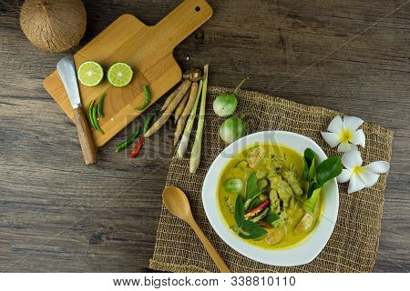 Fish Ball Green Curry With Coconut Curry (kaeng Kheiyw Hwan) On Dark Wooden Background With Thai Tra